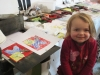 Young artist shows her work.