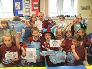 Pupils from St John Cliviger Primary School help Burnley press home their advantage.