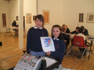 pupils from St Augustines proudly show their work in Mid Pennine Arts, Burnley