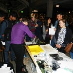 Students printing with Alan Birch at Manchester Museum in conjunction with Whitworth Art Gallery